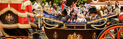 Prince William and Prince Harry in the State Landau Carriage tipping their top hats to each other