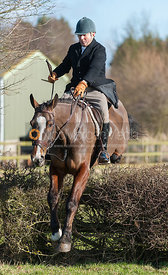 The Earl of Verulam jumping the first hedge