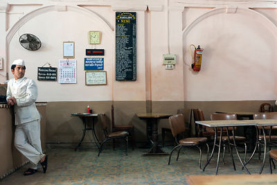 India - Allahabad - A waiter in the Indian Coffee House