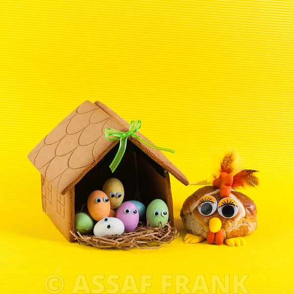 Easter theme made with gingerbread house, Easter eggs and hot cross bun