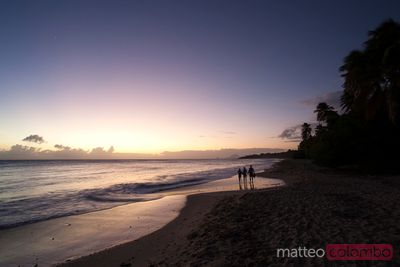 Family at sunset on tropical beach in the Caribbean