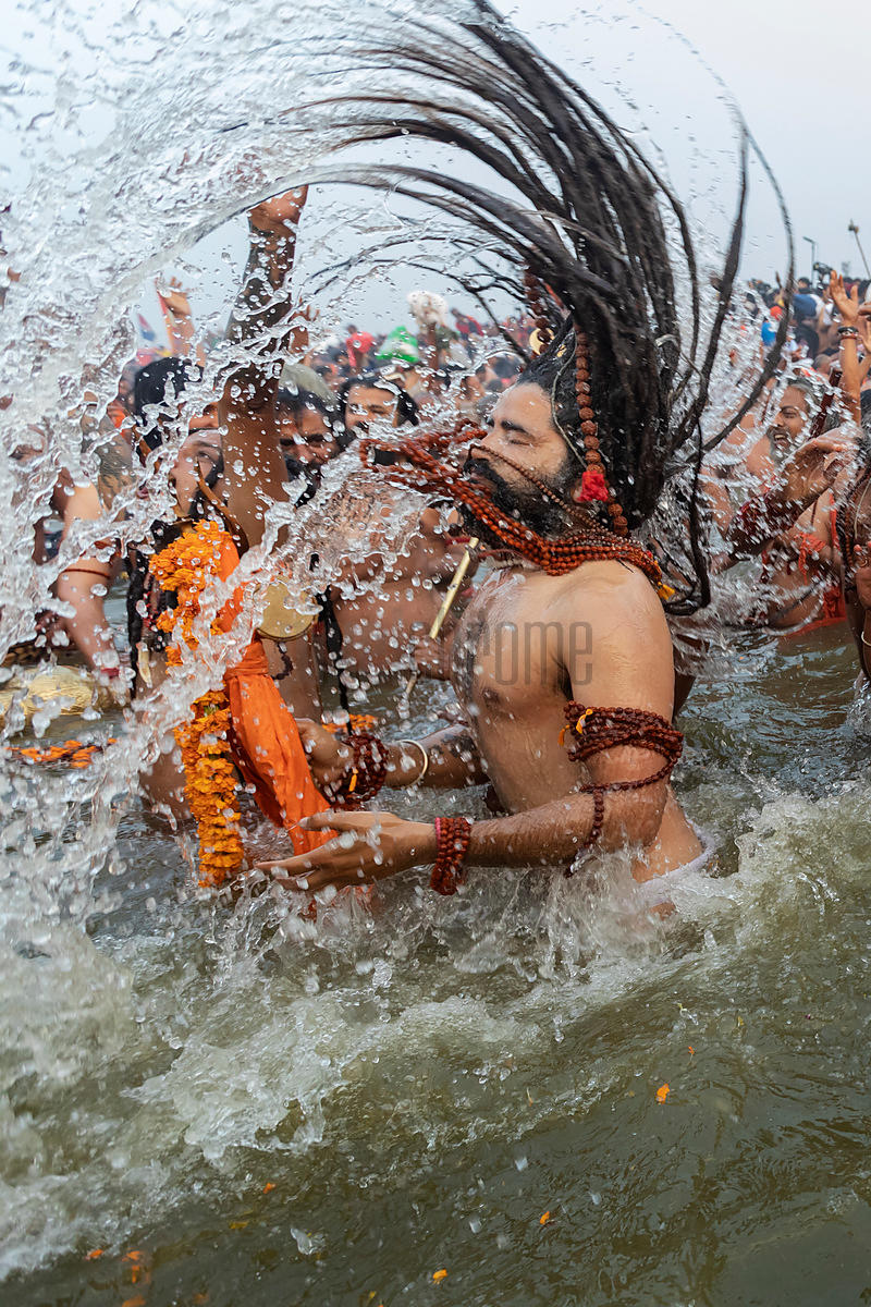 Naga Sadhu from the Juna Akhara Throwing his Dreadlocks back while at the Royal Bath Mauni Amavasya at the 2019 Kumbh Mela