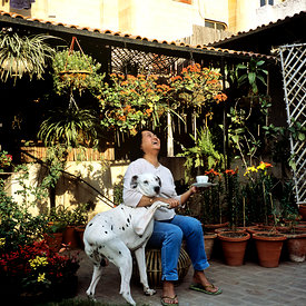 Bela Gupta, Secretary of the All India Kitchen Garden Association and her dog in her roof garden.