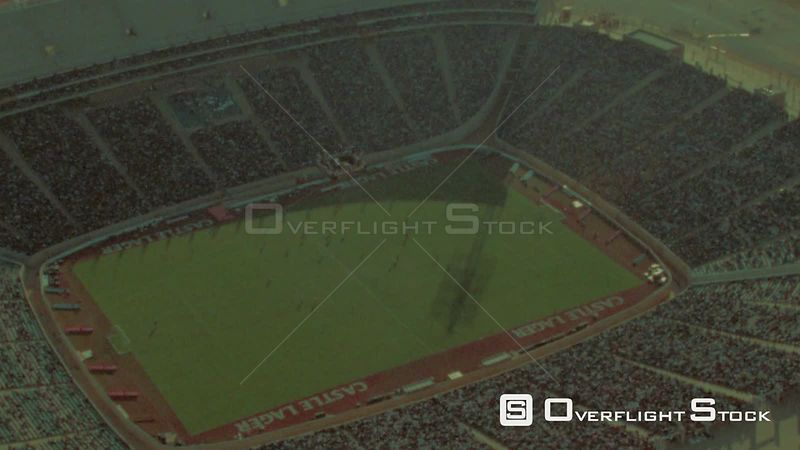 Aerial shot of the FNB stadium filled with spectators watching a soccer game Johannesburg Gauteng South Africa