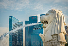 SINGAPORE - OCTOBER 09, 2016: Singapore Merlion Statue Landmark And Cityscape Financial District Background.