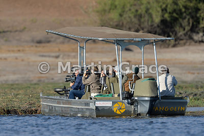 Tourist boat equipped for photographers, River Chobe, Botswana