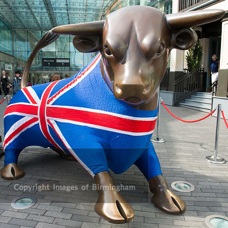 The bronze bull at the Bullring Shopping Centre, Birmingham. Decorated in a Unon Jack jumper.