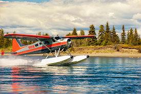 Water plane takes off Lake Iliamna; Alaska, U.S.A.