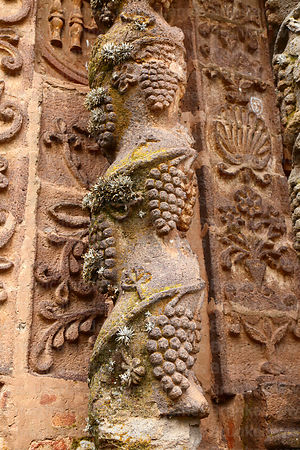 Detail of pillar with carved stone grapes on entrance facade of Santa Cruz of Jerusalem church, Juli, Puno Region, Peru