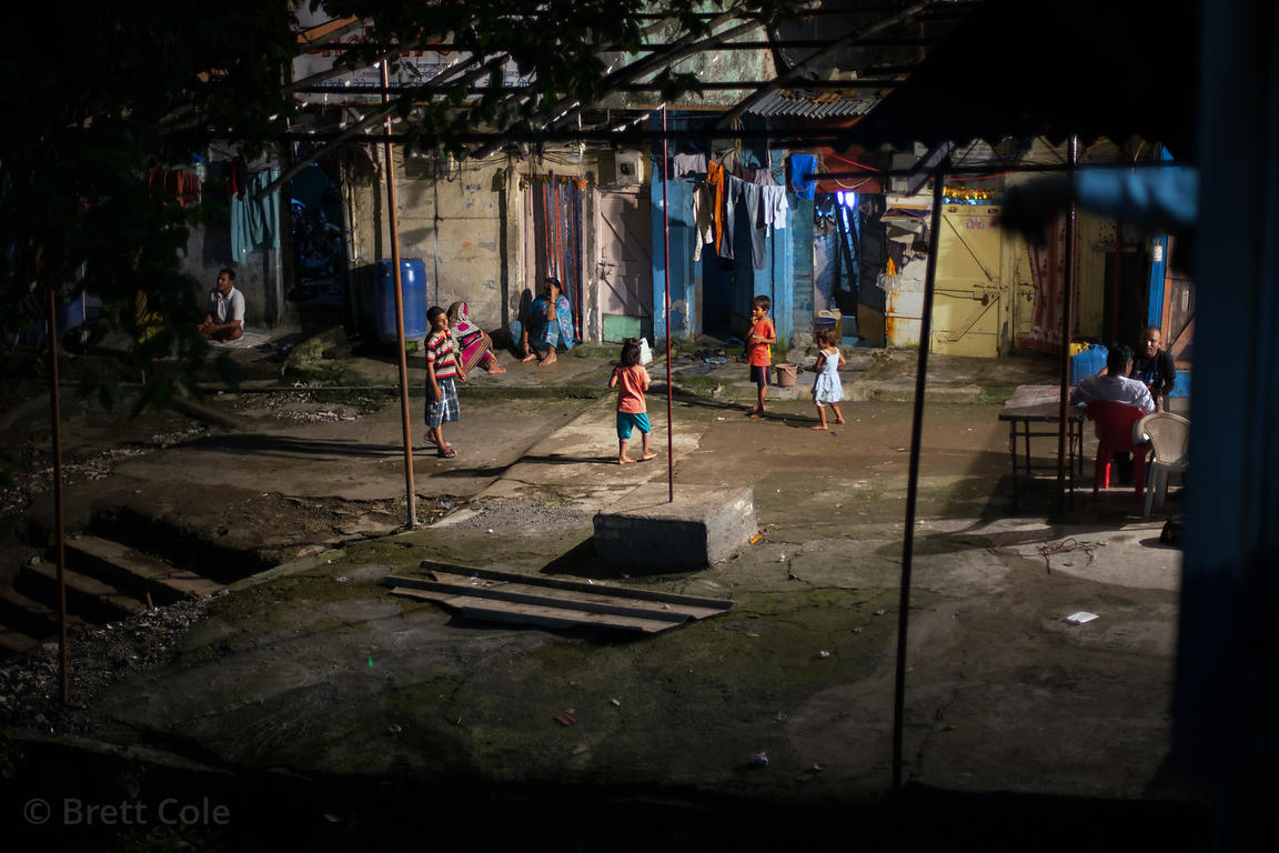 Children play in a courtyard in King's Circle, Mumbai, India.