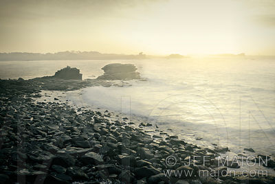 Rocky beach in late afternoon sun