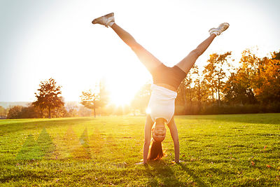 Woman doing a cartwheel outside