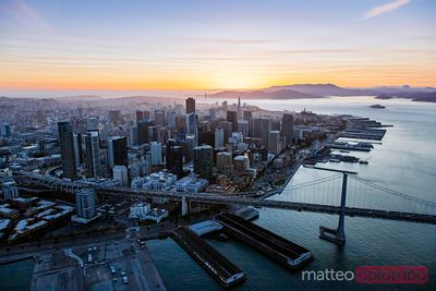 Aerial of downtown and piers at sunset, San Francisco, USA