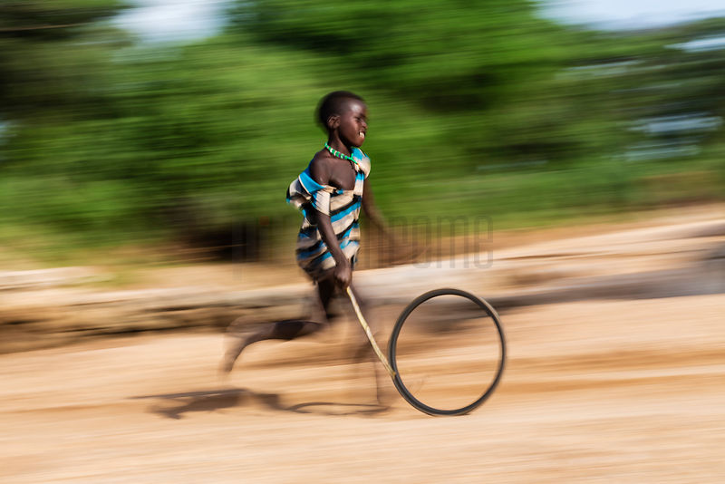 Hamer Boy Running with Wheel