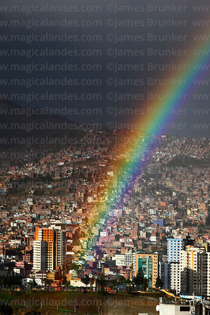 Rainbow over Miraflores district in rainy season, La Paz, Bolivia