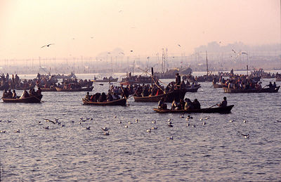 India - Allahbad - Pilgims on the water in boats going to the holy confluence of the Ganges and the Yamuna rivers. Ardh Kumbh...