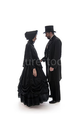 A Victorian couple talking – shot from eye level.