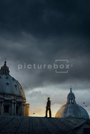An atmospheric image of a mystery men on a rooftop in Rome, Italy.