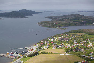 Aerial view over village of Lausvnes (location for sea eagle safaris). Flatanger, Norway, July 2010.