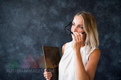 Woman with glasses holding wooden board