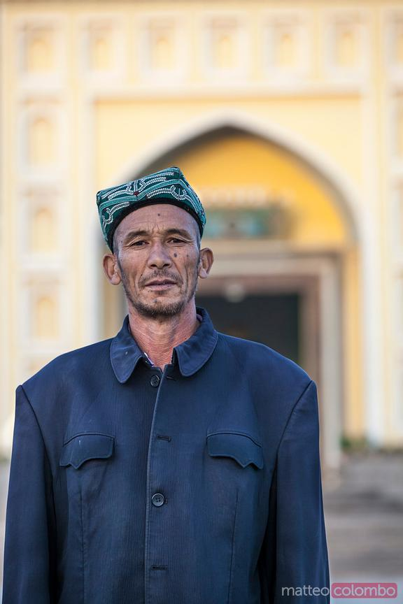 Uighur man in front of Id Kah mosque in Kashgar, China