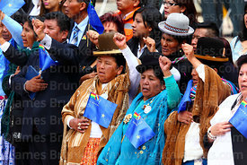 Aymara women holding Maritime Vindication flags during official ceremonies for Dia del Mar / Day of the Sea, La Paz, Bolivia