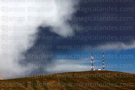 Rainy season storm clouds over mobile phone masts, near Viacha, Bolivia