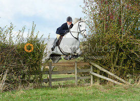 Holly Campbell jumping a hedge near Little Dalby. Quorn Hunt Opening Meet 2018