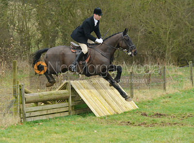 Dean Cripps jumping the hunt jumps at Peake's Covert
