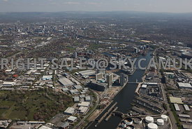 Manchester high level aerial photograph of Salford Quays BBC Media City ITV Coronation Studios with Manchester in the background