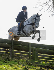 Clare Bell jumping a hunt jump in Flitteris Park