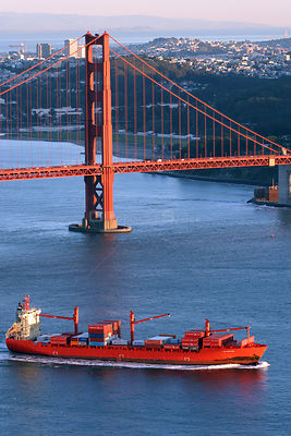 Loaded red tanker beneath the Golden Gate Bridge, San Francisco Bay, California