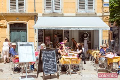 Typical french brasserie with tourists, Aix en Provence, France