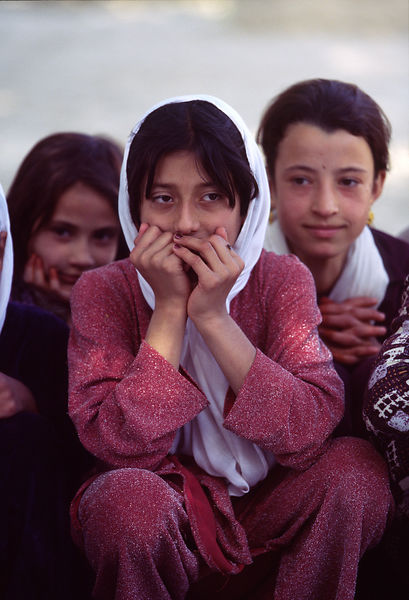 Pupils talking outside their classroom, Mazar-i-Sharif, Afghanistan