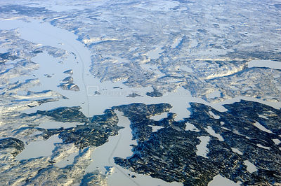 Aerial view of the ice road in the tundra connecting the gold mines to the city of Yellowknife, Northwest Territories, Canada