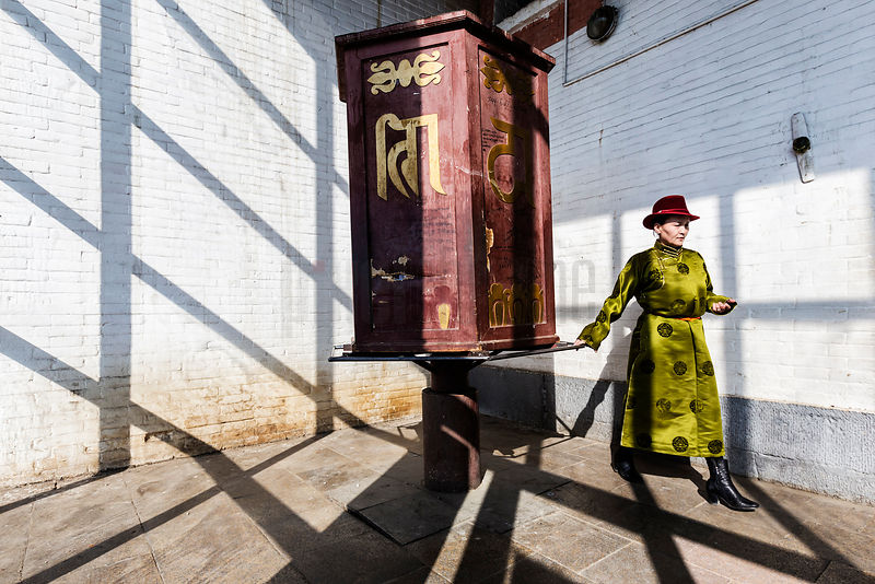 Woman in Traditional Mongolian Dress at Prayer Wheel at Gandan Monastery