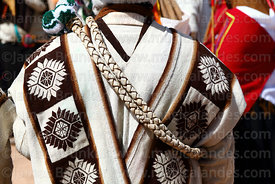 Detail of poncho and leather whip of community leader from Aransaya, Curahuara de Carangas, Bolivia