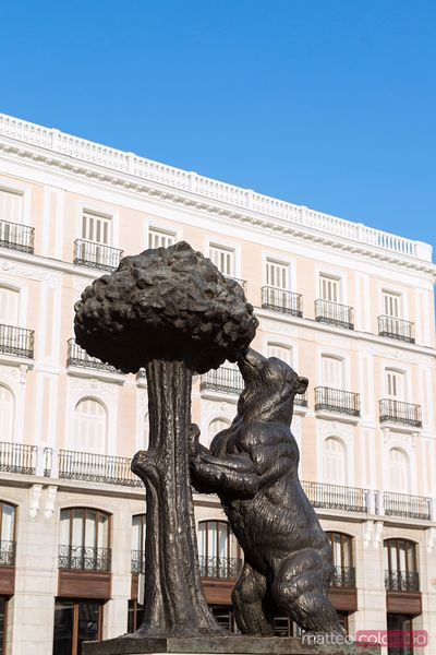 Bear eating berries famous statue symbol of Madrid, Spain