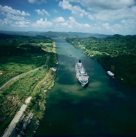 Aerial view of cruise ship, M/V Crystal Symphony, passing through the Panama canal, heading towards Mira Flores Locks, Panama...