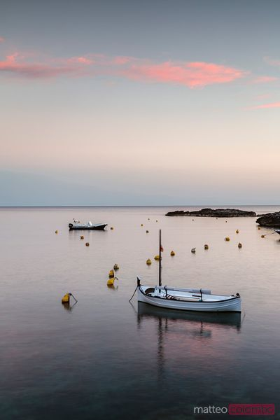 Mediterranean sea and boat at sunset, Menorca, Spain