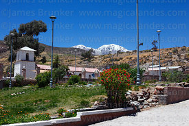 View of main square, San Ildefonso church and Nevados de Putre / Taapaca volcano, Putre, Region XV, Chile