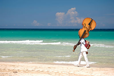 Contrabass Player on Beach