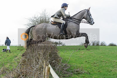 Isobel McEuen jumping a hedge at Ingarsby
