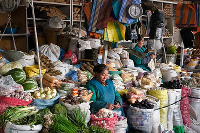 A spice and vegetable vendor at a market in Cusco, Peru