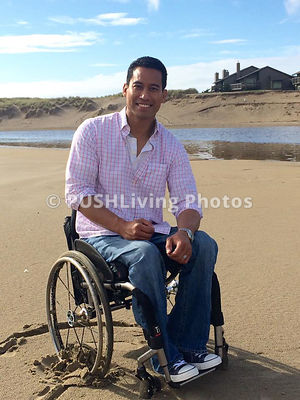 Young man in a wheelchair on the beach