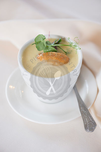 Leek and potato soup with smoked haddock beignet.