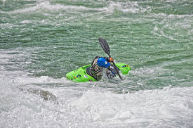 Kayaker balancing kayak on white water; Pacific Northwest