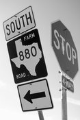 Black and white Texas Farm Road Sign and stop sign