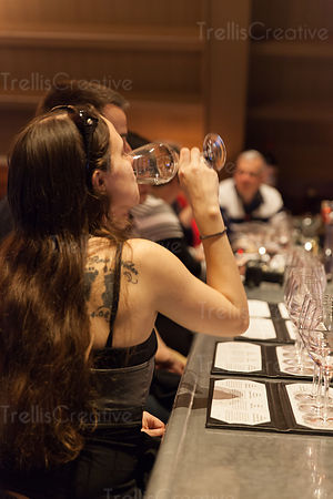 A lady tasting wine at an event