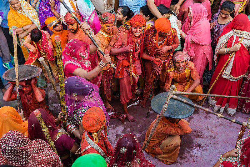 Gopis of Nandgaon Beat the Gops of Nandgaon with Long Sticks (Laths) During Lathmar Holi Celebrations